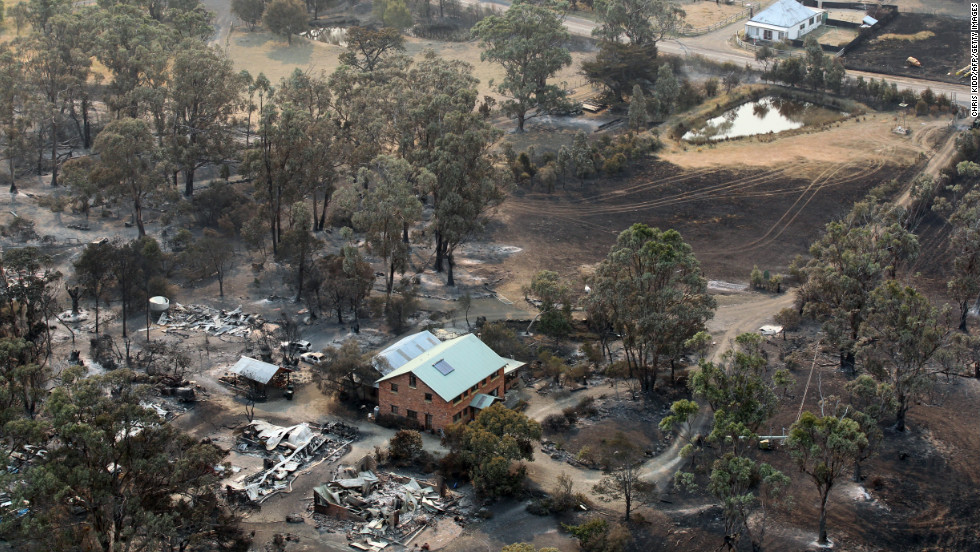 Buildings lie in ruins on Saturday, January 5, from bush fires that hit Dunalley, a town on the Australian island state of Tasmania.