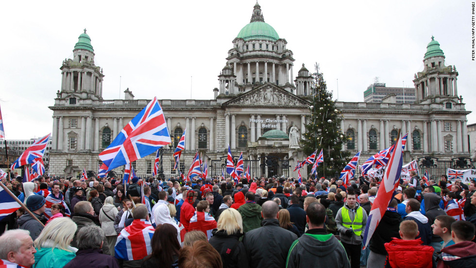 Loyalists march outside Belfast City Hall on Saturday, January 5.