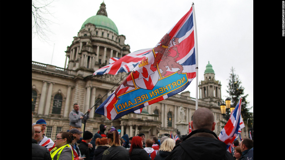 Loyalists holding British union flags march outside City Hall on Saturday.