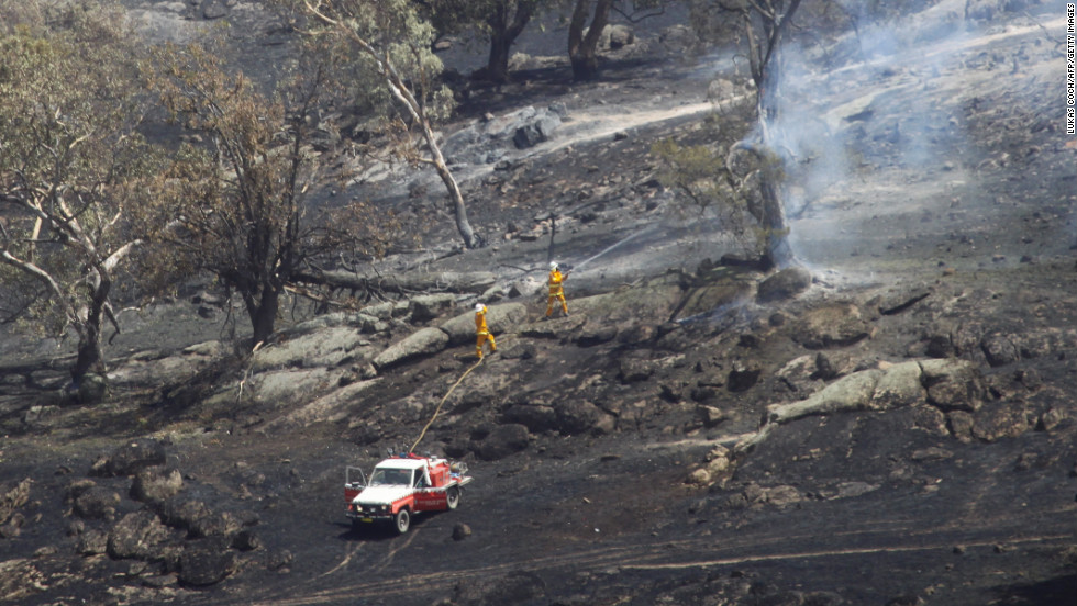 Fire fighters battle a grass fire in Oura, near Wagga Wagga in New South Wales on January 8, 2013.