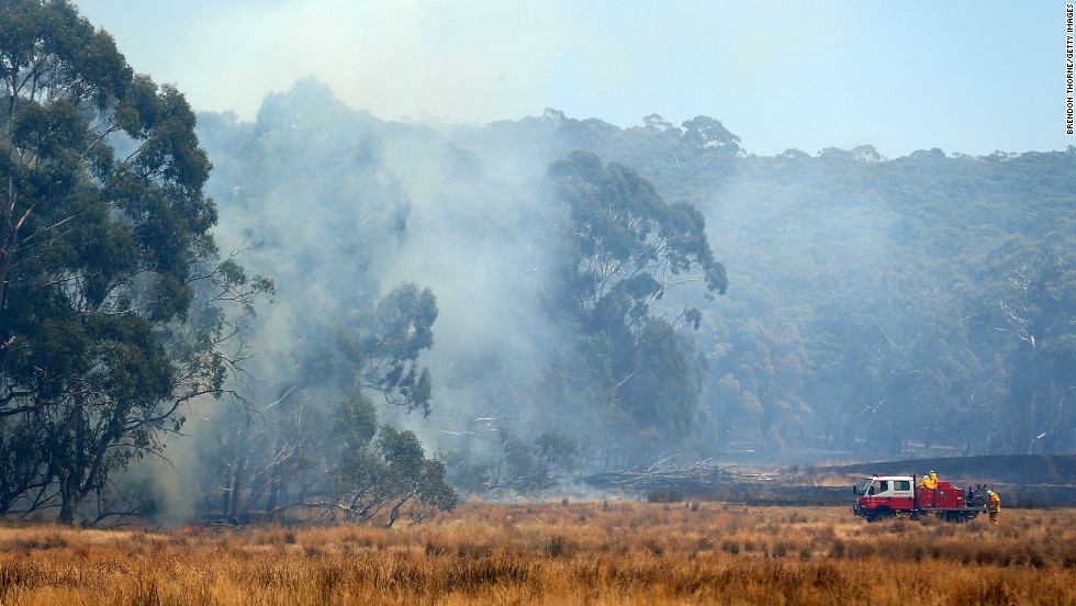 "Firefighters attack a fire from the ground on Wednesday, January 9, in Bungendore, Australia. A ""catastrophic warning"" was lifted, but the fire risk was still considered ""severe"" in the northeastern part of New South Wales. The threat has eased as temperatures have fallen in the southern Australian state, but authorities warn the danger isn't over yet."