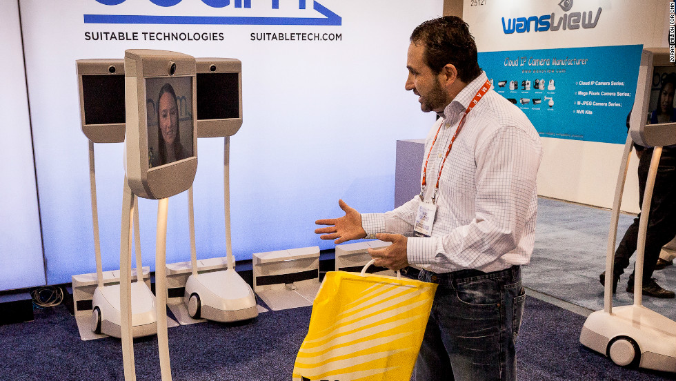 A visitor chats with a woman using the Beam by Suitable Technologies on Wednesday.  The device is mobile and controlled by the remote party via their computer.