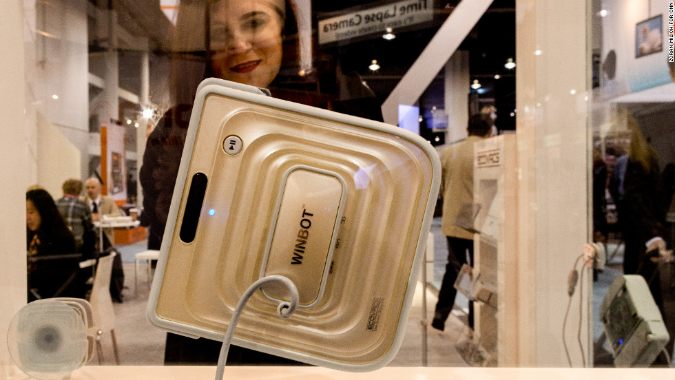 ECOVACS Winbot uses suction to attach itself to and clean the inside and outside of windows.