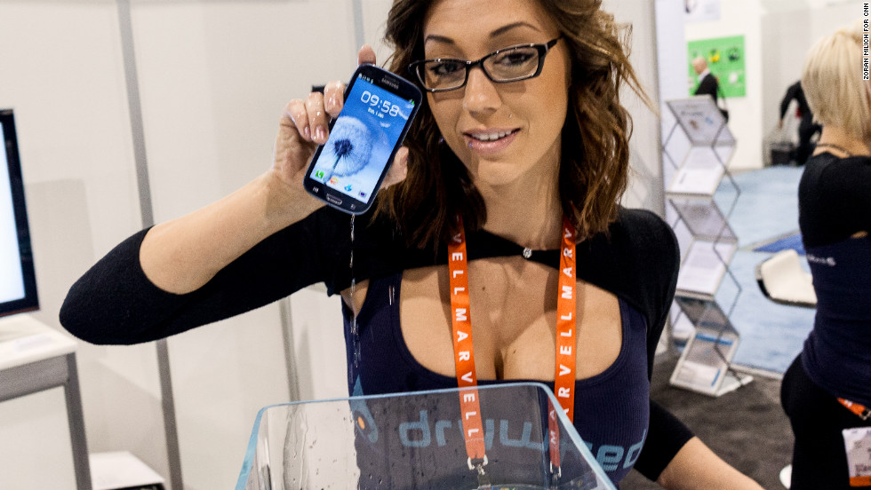 A model demonstrates the DryWired coating that protects devices from liquid exposure during the second day of the Consumer Electronics Show on Wednesday, January 9.