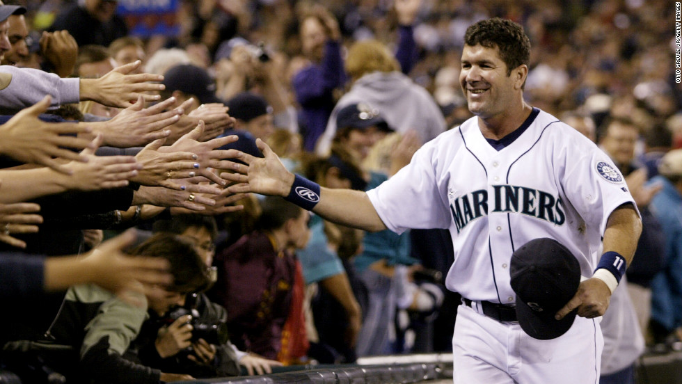 Edgar Martinez of the Seattle Mariners is greeted by fans as he takes a lap around the field during a post-game ceremony honoring his career as a Mariner on October 2, 2004.