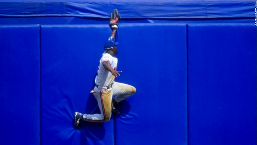 Rondell White of the Montreal Expos tries to catch a long fly ball during a game against the New York Mets in Flushing, New York, on July 12, 1998.