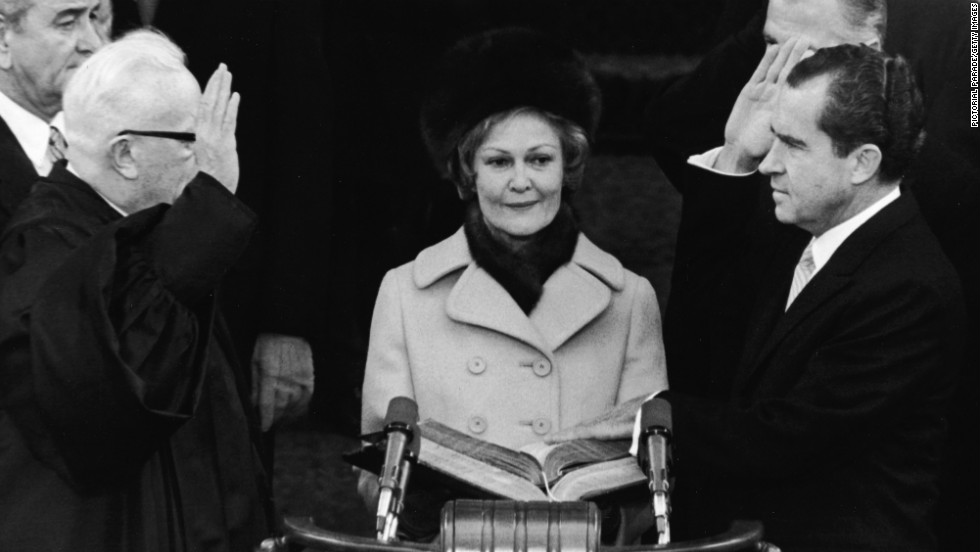 First lady Pat Nixon, center, watches as her husband is sworn in as the 37th president of the United States by Supreme Court Chief Justice Earl Warren on January 20, 1969.