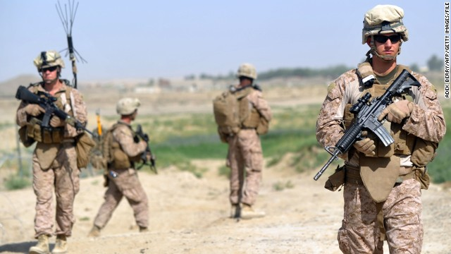 US Marines from Kilo Company of the 3rd Battalion 8th Marines Regiment head out on patrol in Garmser, Helmand Province, last June.