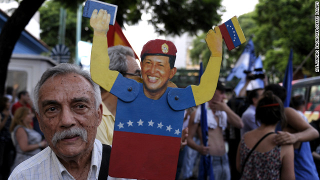 A man holds a figurine of Venezuelan President Hugo Chavez during a rally in support of his recovery in front of the Venezuelan embassy in Buenos Aires on January 8, 2013. The President of the National Assembly Diosdado Cabello announced today that due to health reasons, Chavez will not be able to take the oath to be sworn in for a fourth term in office next January 10. A constitutional fight intensified with the government planning a massive show of support in the streets on the day he is supposed to be sworn in. Chavez, who underwent his fourth round of cancer surgery in Havana nearly a month ago, is suffering from a severe pulmonary infection that has resulted in a respiratory insufficiency. AFP PHOTO / ALEJANDRO PAGNI (Photo credit should read ALEJANDRO PAGNI/AFP/Getty Images)