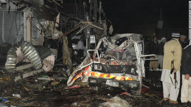 Pakistani security officials examine the site of a deadly bomb attack in Quetta on Thursday.