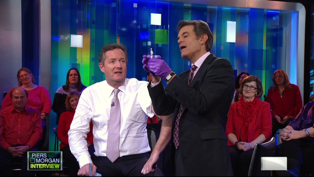 Piers Morgan gets a flu shot