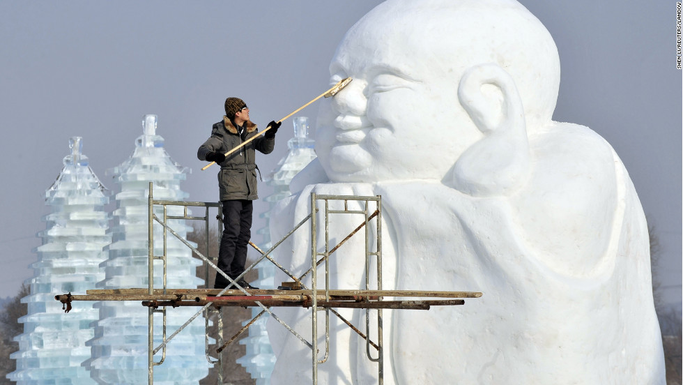 A man polishes a snow sculpture in preparation for Shenyang International Ice and Snow Festival in Liaoning province, China, on Tuesday, January 8.