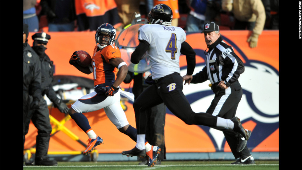 Denver's Trindon Holliday runs past Baltimore punter Sam Koch on a 90-yard touchdown return in the first quarter.