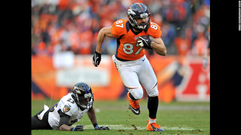 Denver's Eric Decker runs for yardage after the catch against Baltimore's Chykie Brown.