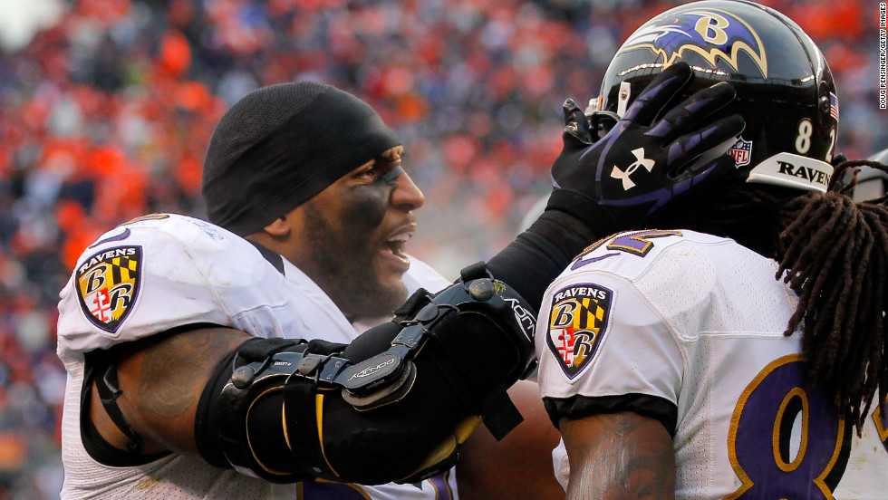 Ravens linebacker Ray Lewis congratulates Torrey Smith after his 32-yard touchdown catch in the second quarter.