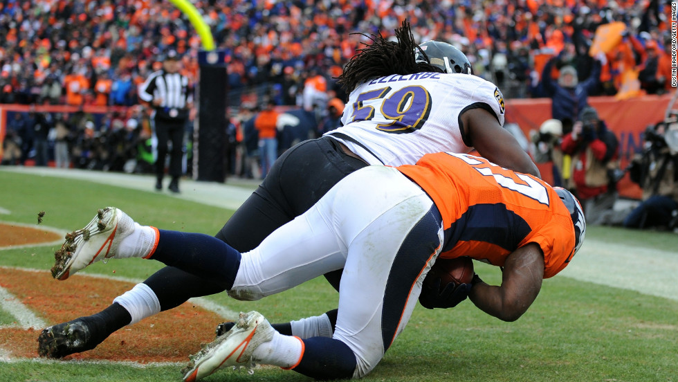 Knowshon Moreno of the Broncos makes catch for a touchdown in the second quarter against the Ravens' Dannell Ellerbe.