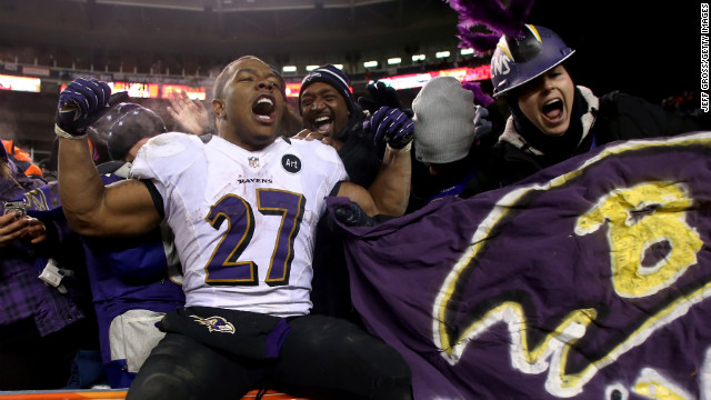 Ray Rice of the Ravens celebrates with fans in the stands after the Ravens victory on Saturday.
