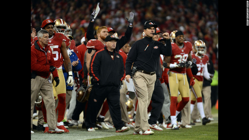 Head coach Jim Harbaugh of the 49ers celebrates a field goal at the end of the second quarter against the Packers on Saturday.