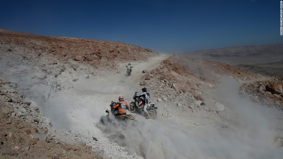 Unidentified bikers and ATV riders compete during Stage 4 between Nazca and Arequipa, Peru, on Tuesday, January 8.