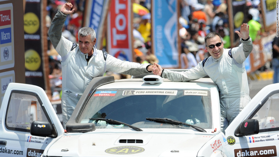 France's Jean-Marc Verrier, left, and Herve Toscano wave to the crowd  in their Chevrolet Springbok prototype during the 2013 Dakar Rally departure ceremony in Lima on January 5.