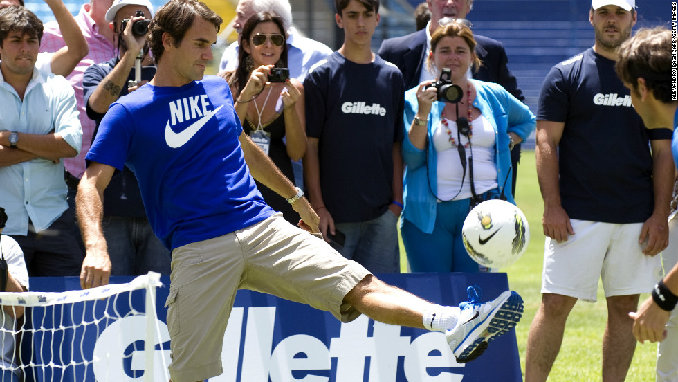 Federer controls the ball during a soccer-tennis exhibition match with Argentinian Juan Martin Del Potro and former footballer Gabriel Batistuta (both out of picture) at the Bombonera stadium in Buenos Aires.