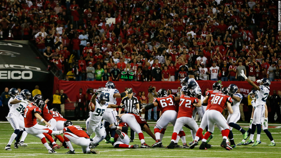 Matt Bryant of the Atlanta Falcons kicks the game-winning field goal in the fourth quarter against the Seattle Seahawks during the NFC divisional playoff Game at Georgia Dome on Sunday, January 13, in Atlanta.