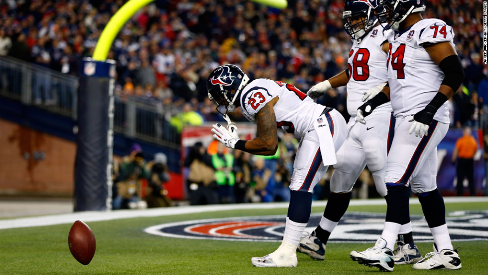 Arian Foster of the Texans celebrates after scoring a touchdown in the second quarter against the Patriots on Sunday.