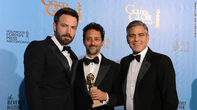 Ben Affleck (L) poses in the press room with producers Grant Heslov (C) and George Clooney with the award for best motion picture drama for 'Argo' at the Golden Globes awards ceremony in Beverly Hills on January 13, 2013.