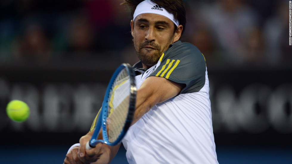 Cyprus's Marcos Baghdatis hits a return against Spain's Albert Ramos on January 14. Baghdatis won 6-7(0) 7-6(4) 6-4 3-6 6-3.