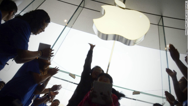 Apple staff welcoming customers in the new Apple store at WangFujin business district in Beijing on October 20, 2012.