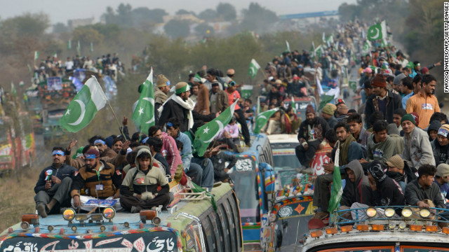 Supporters of Pakistani religious leader Tahir-ul Qadri take part in the protest march at Domeli, about 100 kms from Islamabad on January 14, 2013.
