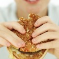boy eating hamburger fast food