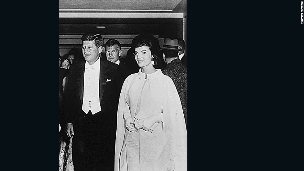 President John F. Kennedy arrives with wife Jacqueline for an inaugural ball in 1961.