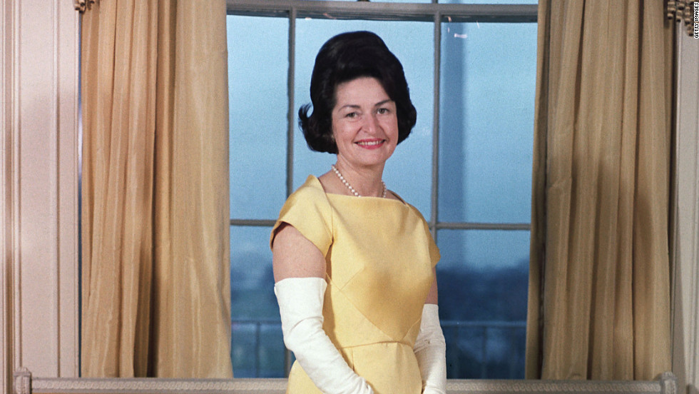 Lady Bird Johnson poses for a portrait before President Lyndon Johnson's inaugural ball in 1965.