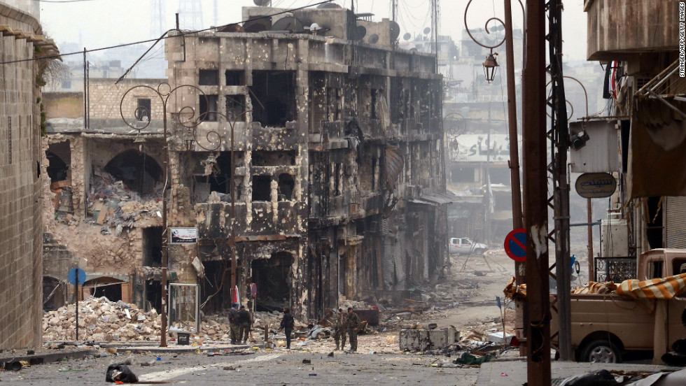 Syrian government troops take position in a heavily damaged area in Aleppo on Saturday, January 12.