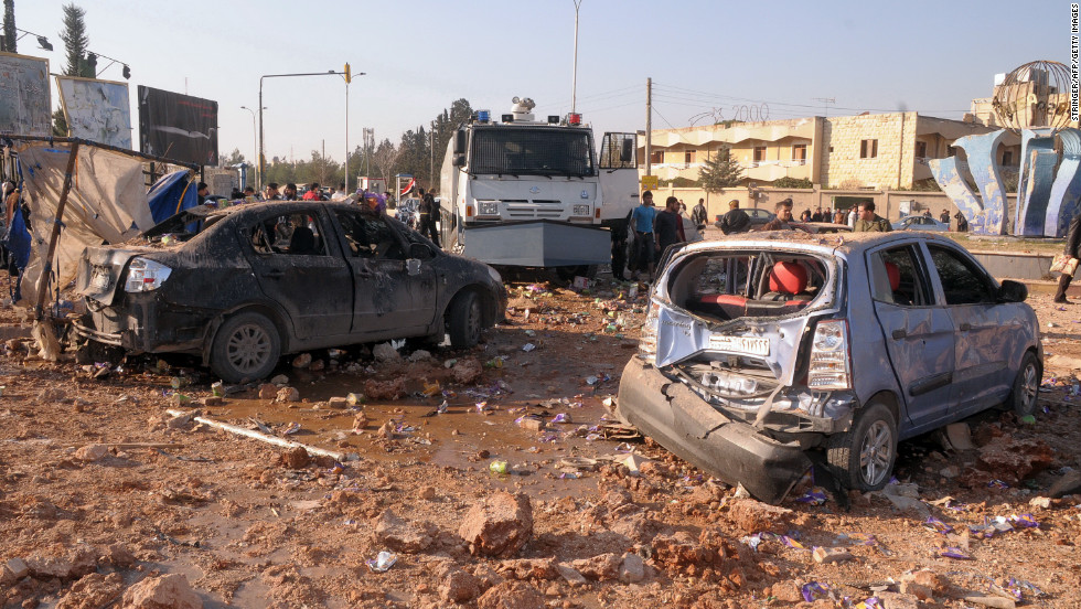 Damaged vehicles sit between dormitories and the architecture facility at Aleppo University, following an explosion on Tuesday, January 15. A monitoring group reported deaths and dozens of injuries.