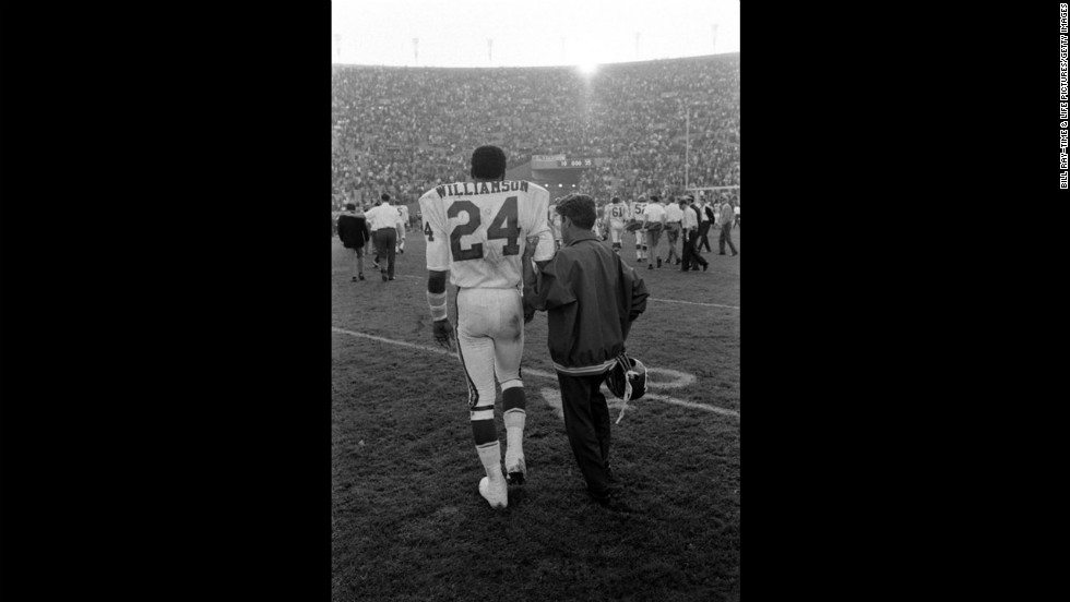 "Fred ""The Hammer"" Williamson led from the field at the end of the first Super Bowl, 1967. Williamson broke his arm during the game."