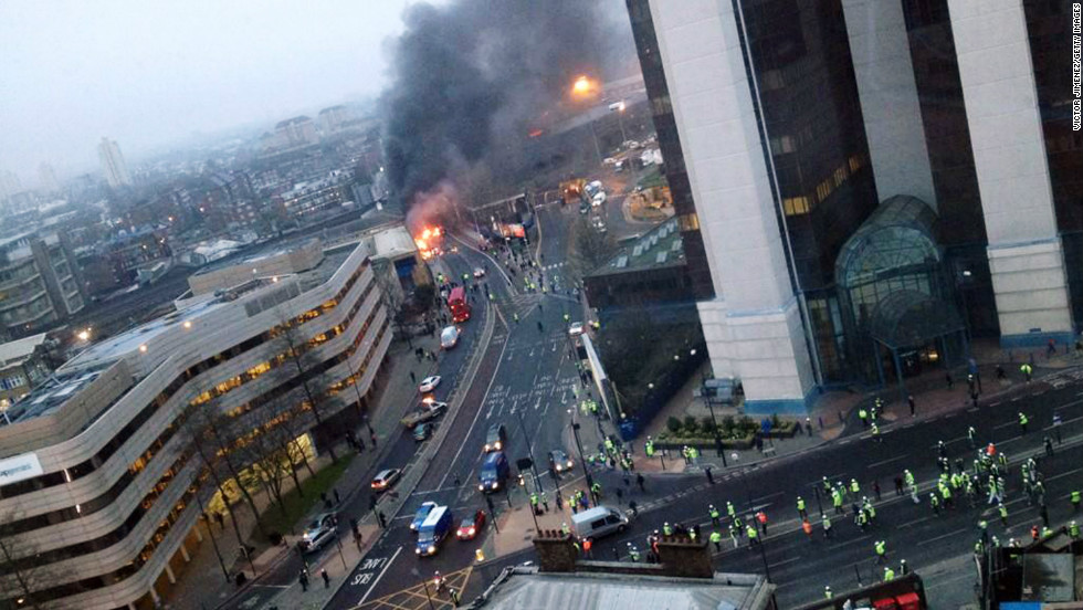Smoke pours from the burning debris of a helicopter which crashed in the Vauxhall area. The helicopter appeared to hit a crane attached to the nearby St Georges Wharf Tower before plunging into the road below during the morning rush hour.