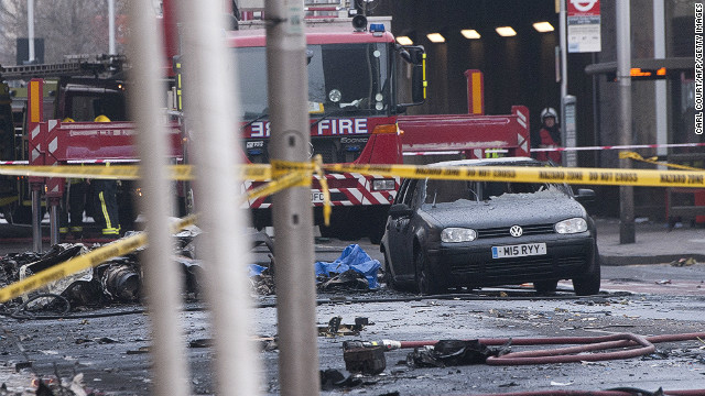 Debris and a burntout car are pictured at the scene of a helicopter crash in central London.