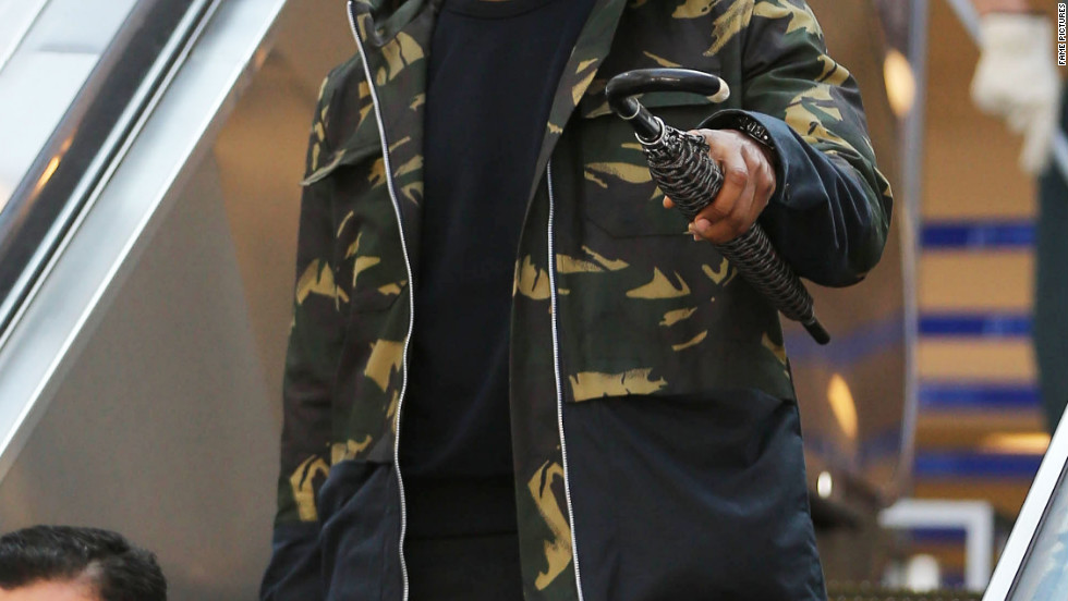 Usher arrives at the airport in Los Angeles.