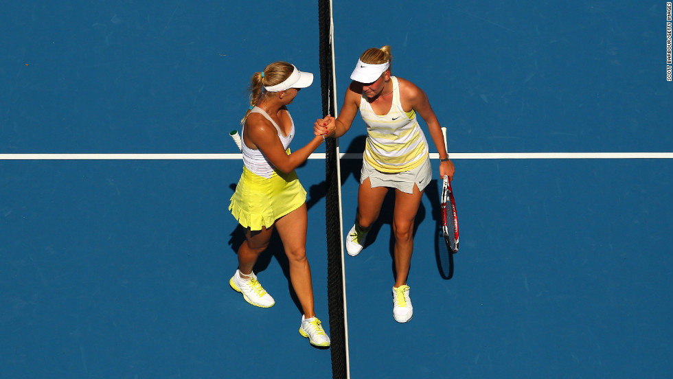 Caroline Wozniacki of Denmark, left, shakes hands with Croatian Donna Vekic on January 17 after defeating her 6-1, 6-4.