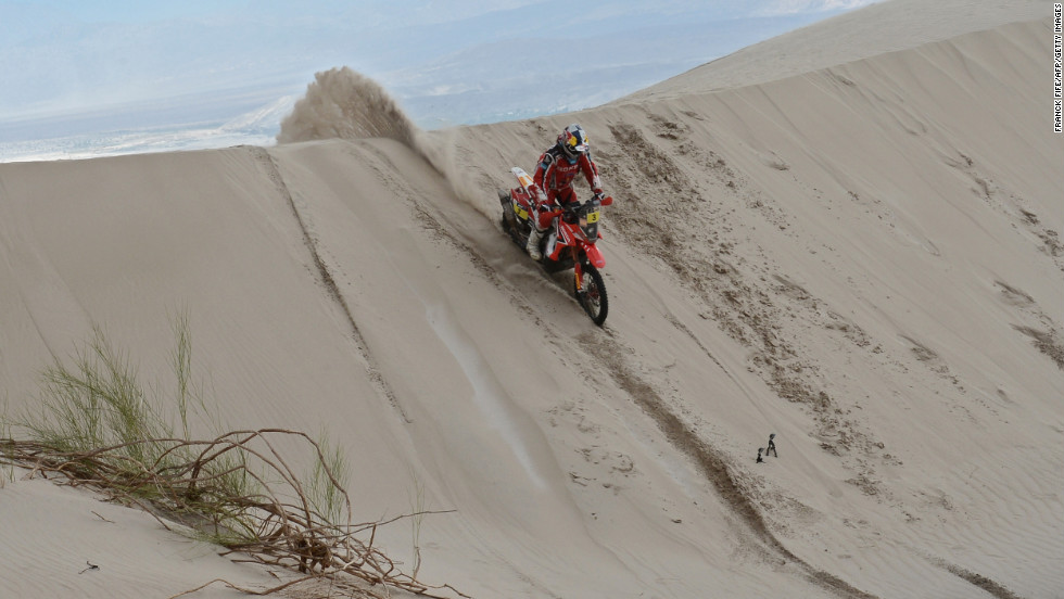 Honda's rider Helder Rodrigues of Portugal speeds down a dune on the leg between La Rioja and Fiambala on January 16.