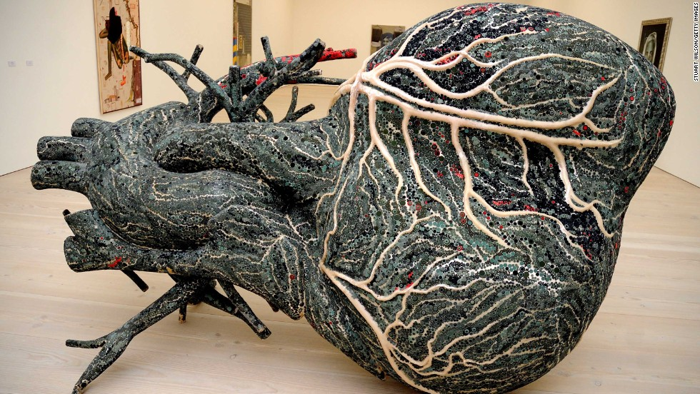 "In 2010, Kher participated in a major exhibition at the Saatchi Gallery called The Empire Strikes Back: Indian Art Today.  Her fiberglass sculpture, ""An Absence of Assignable Cause"" (2007) is an enormous heart, meant to belong to a blue whale, decorated with bindis."