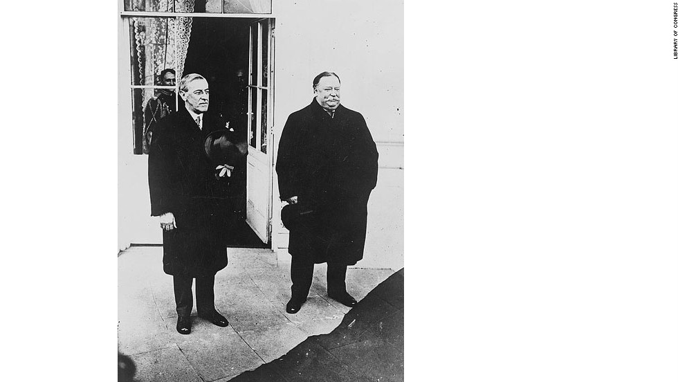 Top hats and overcoats were the appropriate garb for Woodrow Wilson's chilly 1913 inauguration. Here, Wilson, left, stands with outgoing President Howard Taft.