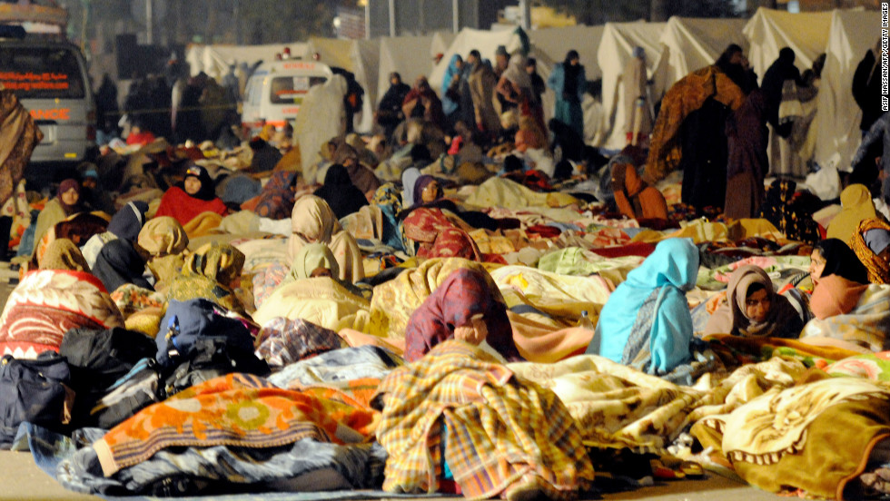 Protesters rest on the third day of the rally in Islamabad on January 16.