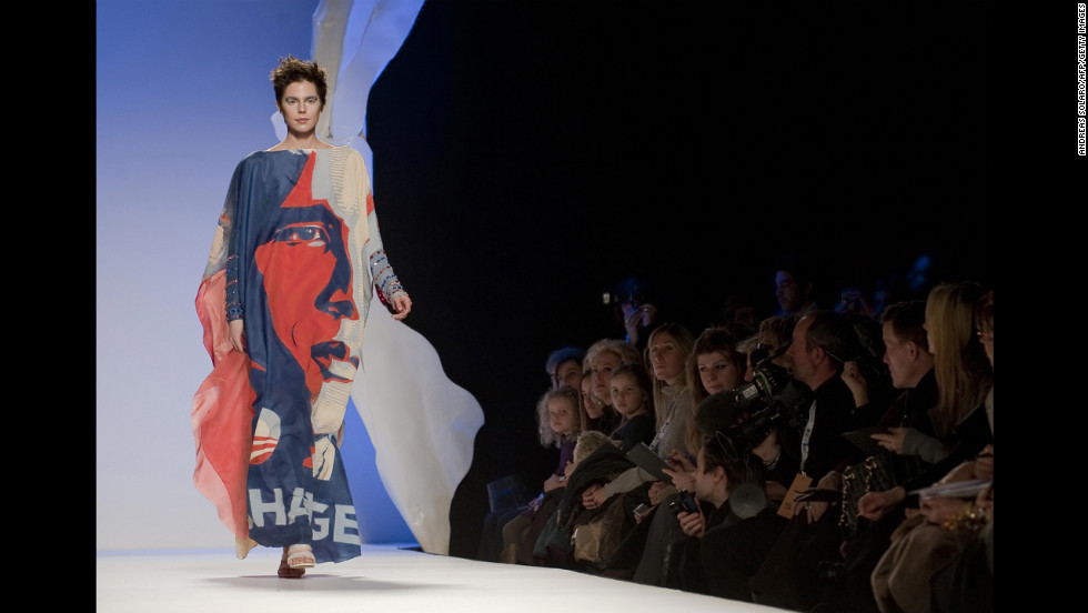 ITALY: A model displays a dress with a portrait of Obama as part of Italian fashion house Gattinoni Haute Couture's spring-summer collection 2009 during the AltaRomAltaModa on February 1, 2009, in Rome.