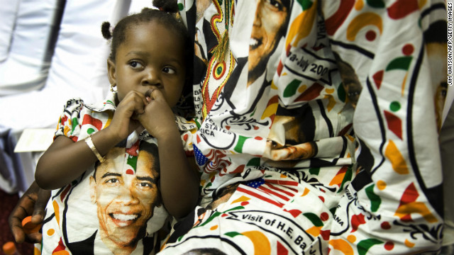 Princess Smith, 2, sits with her father Francis on July 11, 2009 as they await President Barack Obama's arrival in Accra.