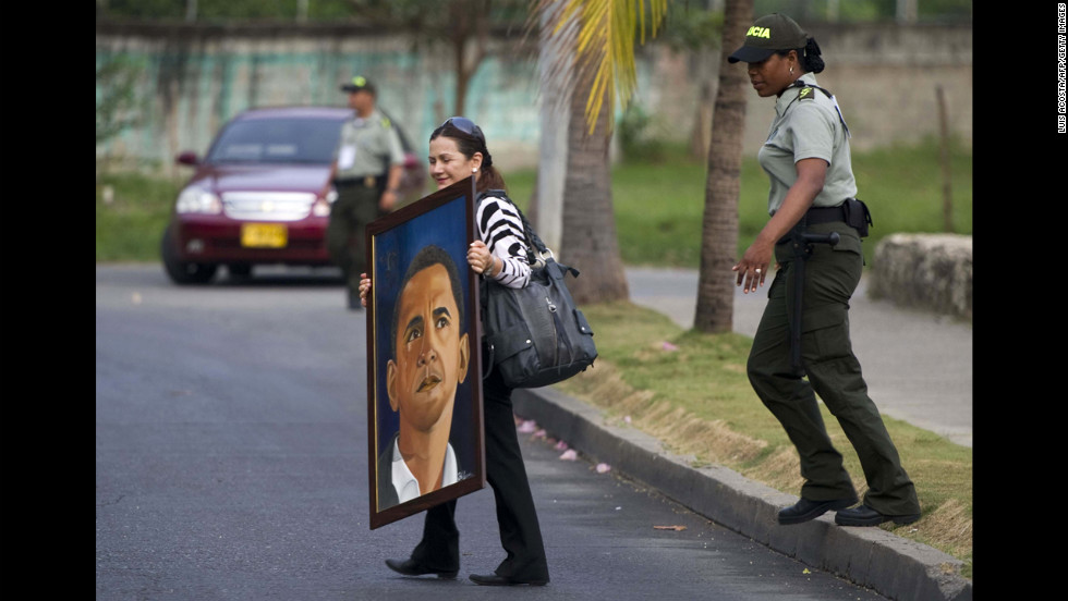 COLOMBIA: Blanca, a Colombian amateur painter and fan of Obama, carries a painting while trying to reach the hotel in Cartagena where the president was staying to give him the painting on April 12, 2012.