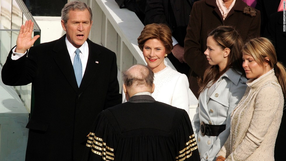 George W. Bush stands next to his wife, Laura, and his two daughters at his second inauguration on January 20, 2005.