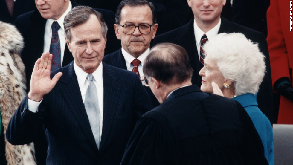 Chief Justice William Rehnquist administers the oath of office to President George H. W. Bush on January 20, 1989.